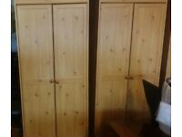 A pair of pine effect solid wardrobes set VGC