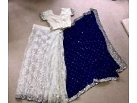 Stunning velvet blue and white lace sari with pleats and free petticoat.