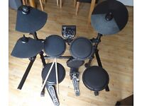 Ion Session Pro electronic drum set by Alesis with drumsticks and headphones