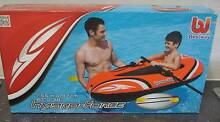 Small inflatable boat with paddles Cairns Cairns City Preview