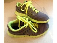 Gray and green Nike kids shoes size 1.5