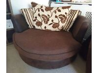 DFS brown and beige 2 seater swivel chair, 3 seater sofa and storage footstall