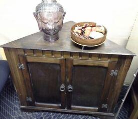 Darkwood corner cabinet.