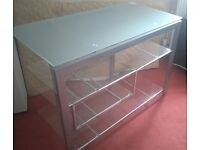 Glass and silver entertainment unit