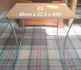 table with light wood top and grey legs
