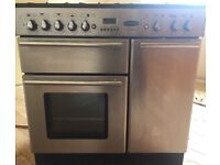 Dual fuel range cooker. Stainless steel. 5 burner. Excellent oven, selling due to moving.