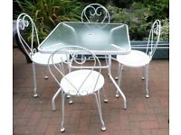 WHITE METAL & GLASS GARDEN TABLE & FOUR WHITE METAL CHAIRS