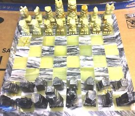 A full set of vintage onyx Aztec design Chess Pieces & Solid Heavy 14in Square onyx Board