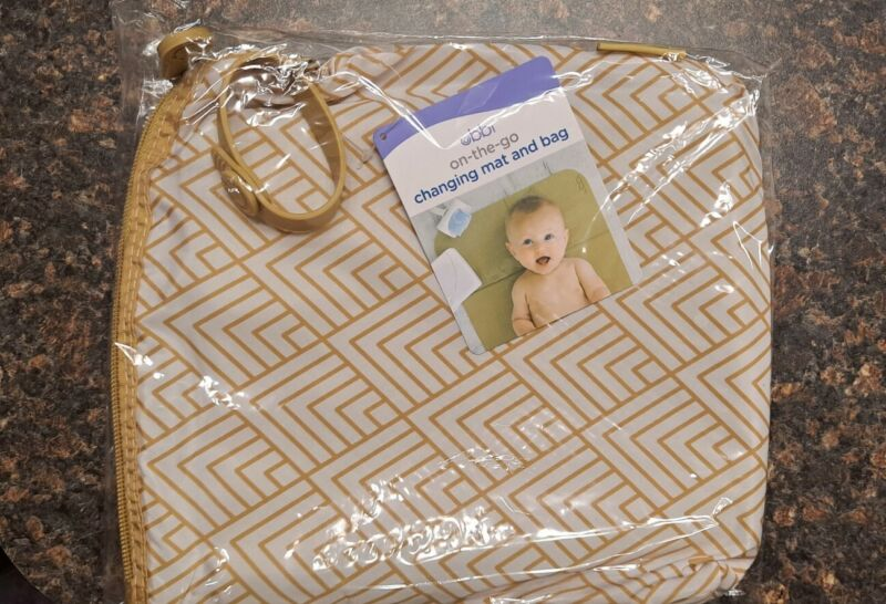 BumpLife On-The-Go Baby Changing Mat & Bag Holder Ivory Color. NWT