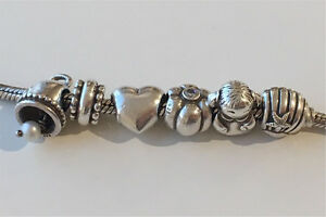 Pandora Silver Bracelet with 6 (Discontinued) Silver Charms Spring Hill Brisbane North East Preview