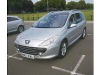 Peugeot 307sw estate. With a panaromic roof.