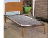 2 ft 6 inch metal bedframe with wooden headboard.