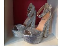 Brand new glitter platform shoes. Size 4