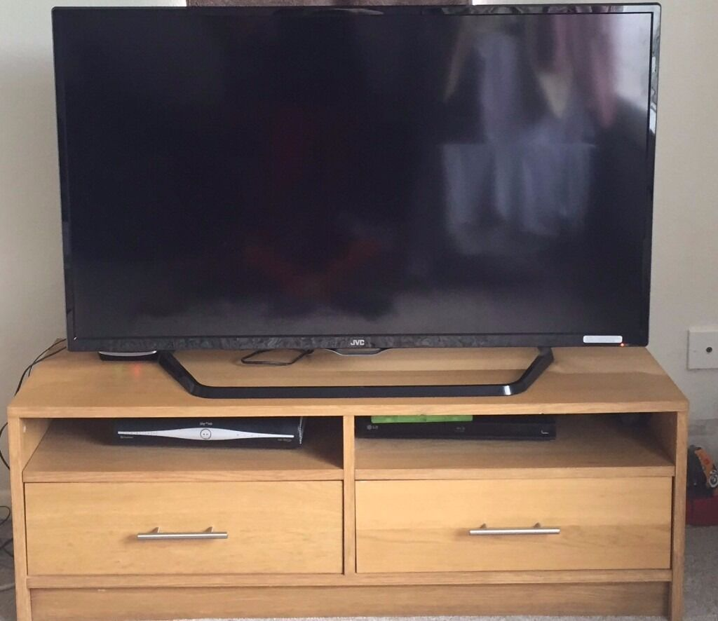 Benno oak effect tv benchin Waltham Abbey, EssexGumtree - Benno TV Bench in used but good condition few wear and tear dents and scratches. Originally had sliding draws mechanism but broke so replaced with brand new stainless steel handles. Collection only as no vehicle. Need quick sell. Other product info...