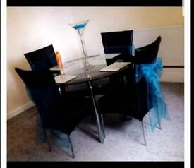 Round two tier black glass table