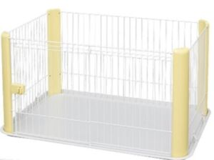 Dog cage and pee pad holder.