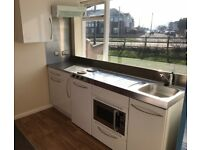 Elfin Kitchen Units including fridge, sink, cabinets and Daewoo microwave