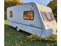 4 berth Lunar Zenith caravan with full awning and caravan cover.