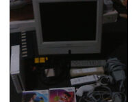 Nintendo wii with a flat screen tv & 2 games