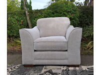 A New Ashley Manor Biscuit Natural Fabric Arm Chair.