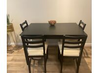 Dining table and 4 chairs (Immaculate Condition)