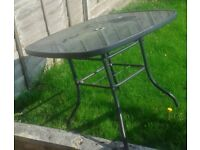 Patio/Garden table with 4 matching chairs good condition