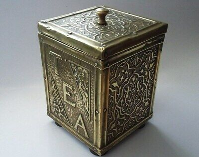 Very good looking antique wooden tea caddy with brass exterior and metal lining.