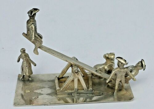 Dutch silver miniature toy group of men on a seesaw in Tricorn hats