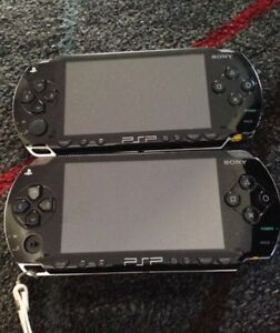 2 PSP's with 7 movies and 8 games