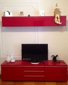 Red ikea TV unit and DVD case above. Picture from Internet.