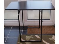 BLACK SLIDING LEAF DINING TABLE IN EXCELLENT NEW CONDITION, BARGAIN ONLY £40 CAN DELIVER