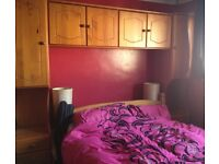 overhead units, wardrobe and chest of draws with mirror