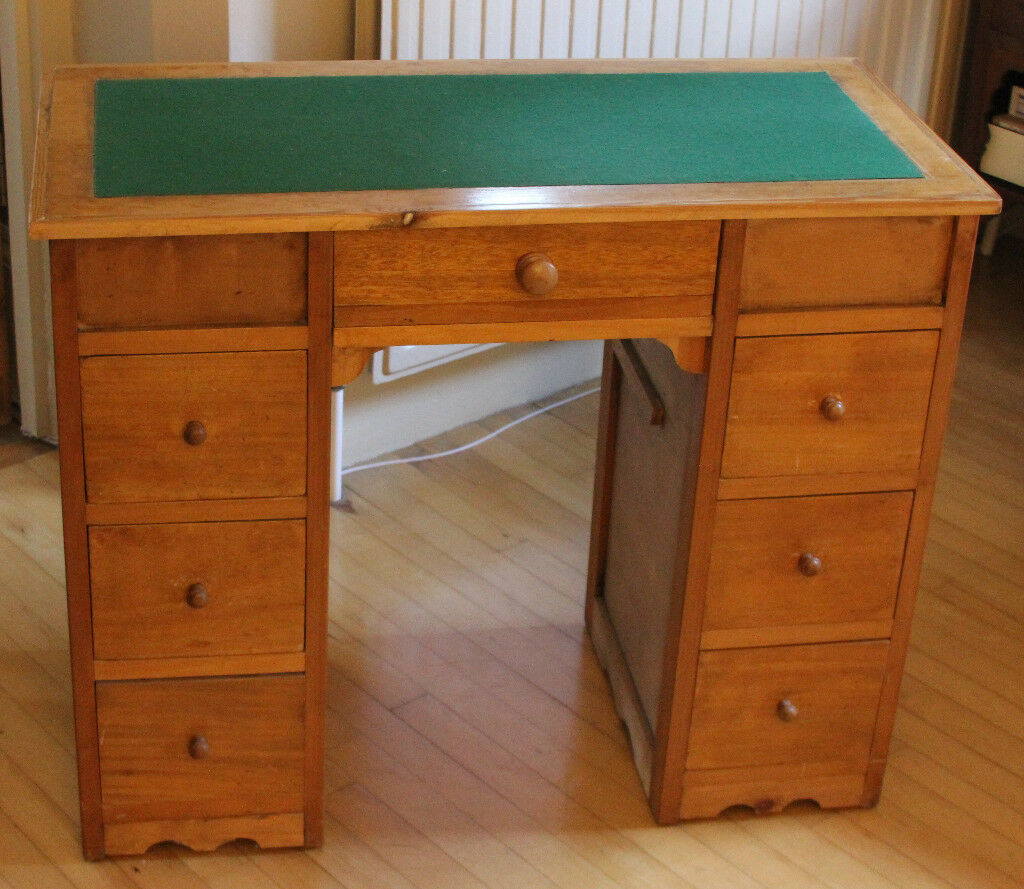 Attractive small wooden desk with 7 drawers, green cloth top - well used but still good