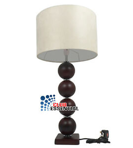 bedside table tall wooden balls design stand with cream mat shade lamp. Black Bedroom Furniture Sets. Home Design Ideas