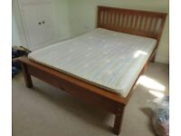 Good quality wooden bed with matress.