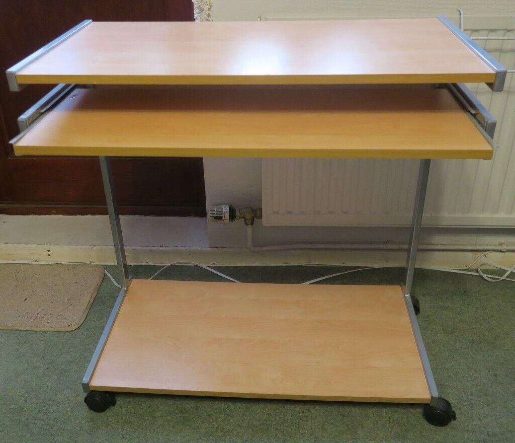 Computer desk on wheels with extending 2nd layer keyboard platform