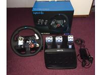PS4 Logitech g29 steering wheel with pedals and the original box cones with 2 racing games