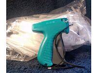 Tagging gun and bag of tags