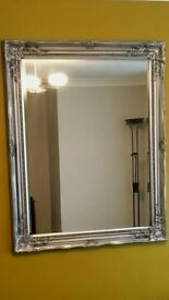 Large silver ornate wall mirror.