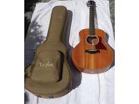 As new Taylor GS Mini Mahogany acoustic guitar