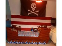 REDUCED BY £100, HAS TO GO! PIRATE BED. standard single with new mattress. Accessories included.