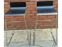 2 bar stools. Metal frame, black wood seat. Seat height 74cm. In excellent condition.