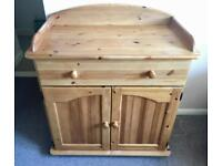 Solid wood pine changing table cupboard unit with drawer and shelf.