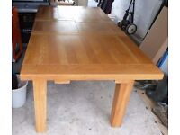 Solid oak extendable conservatory table and four chairs