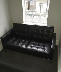 Two person black leather sofa