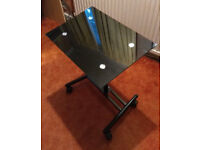 Laptop table with tilted glass top