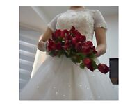Stunning white ball gown wedding dress in a size 8 with lace details and sequence bodice