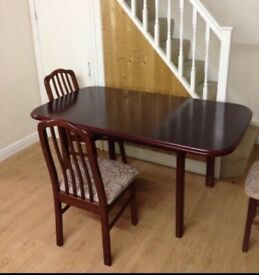 Brown wooden table with 4 matching chairs