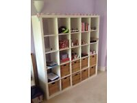 IKEA white square shelving with baskets