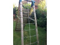 Plum Uakari Wooden Garden Swing Set With Climbing Frame